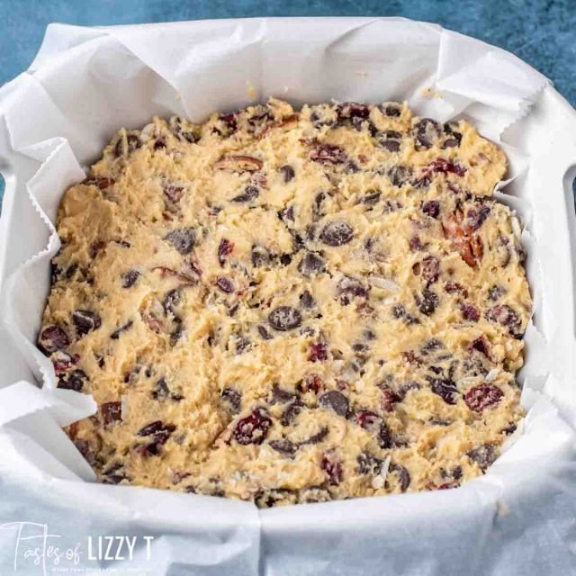 unbaked chocolate chunk cranberry coconut blondies in a baking pan
