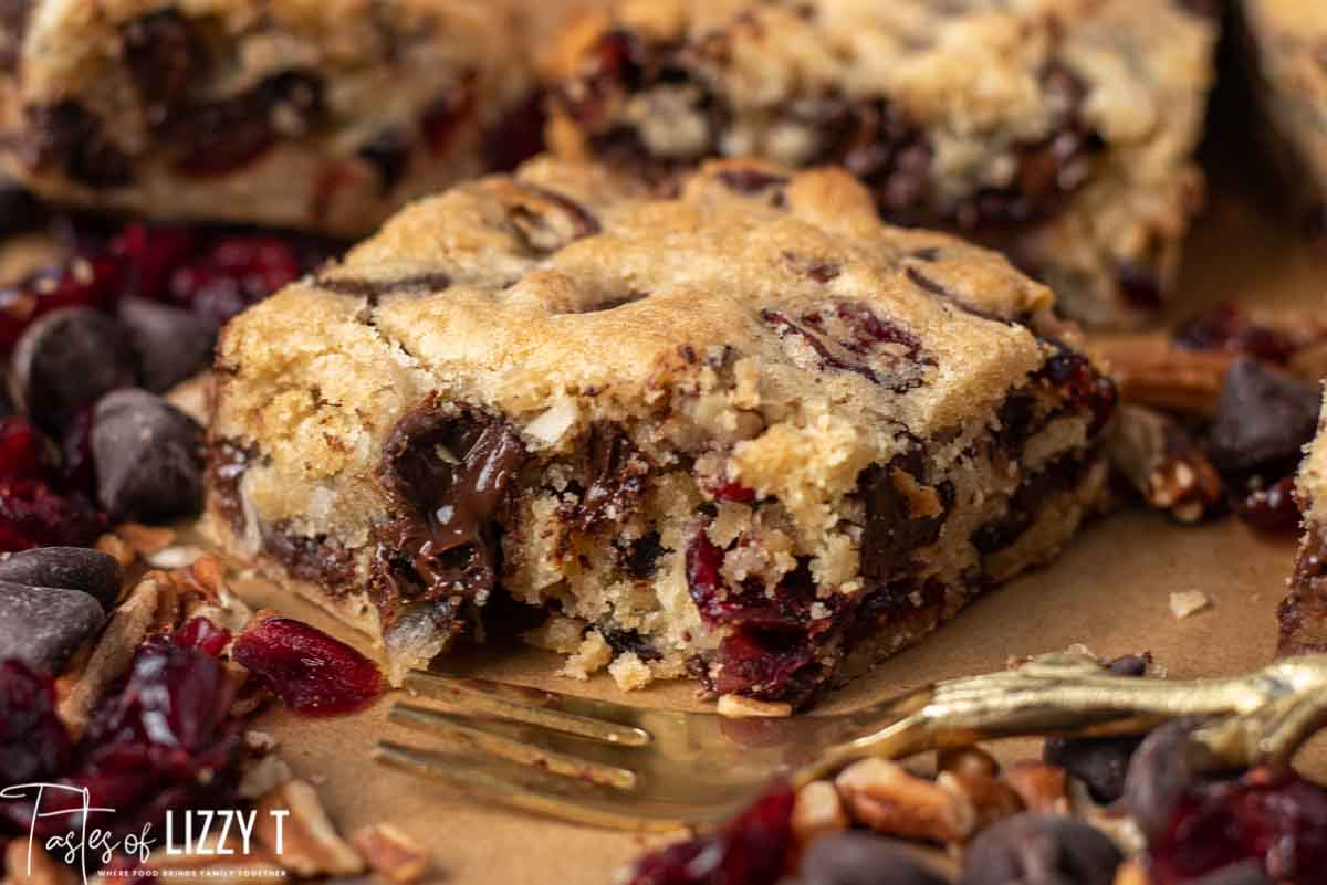 chocolate chunk cranberry coconut blondies with a bite out of it