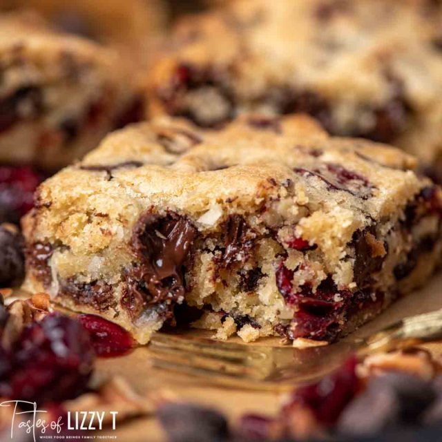 Loaded Cranberry Coconut Blondies with a bite out of it