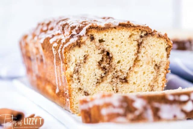 loaf of cinnamon roll quick bread with one piece cut