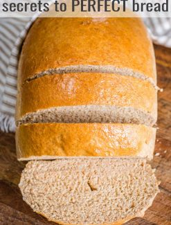 a loaf of half sliced honey wheat bread