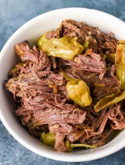 bowl of shredded mississippi pot roast with pepperoncinis