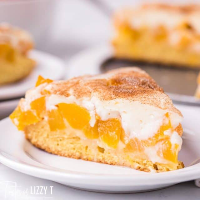 slice of peaches and cream cake on a plate