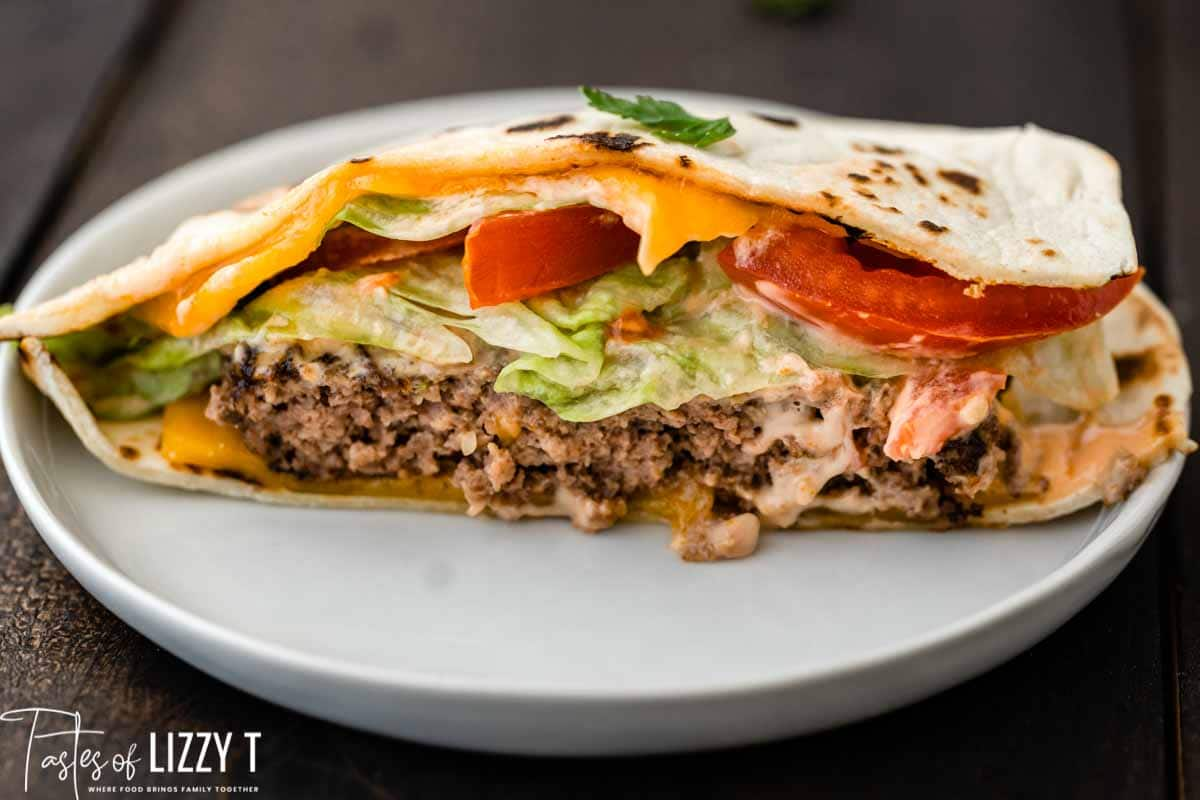 half of a quesadilla burger on a plate
