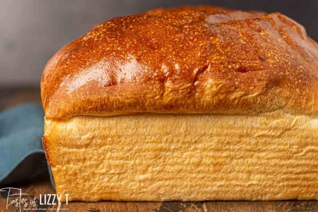 loaf of golden brown sourdough bread