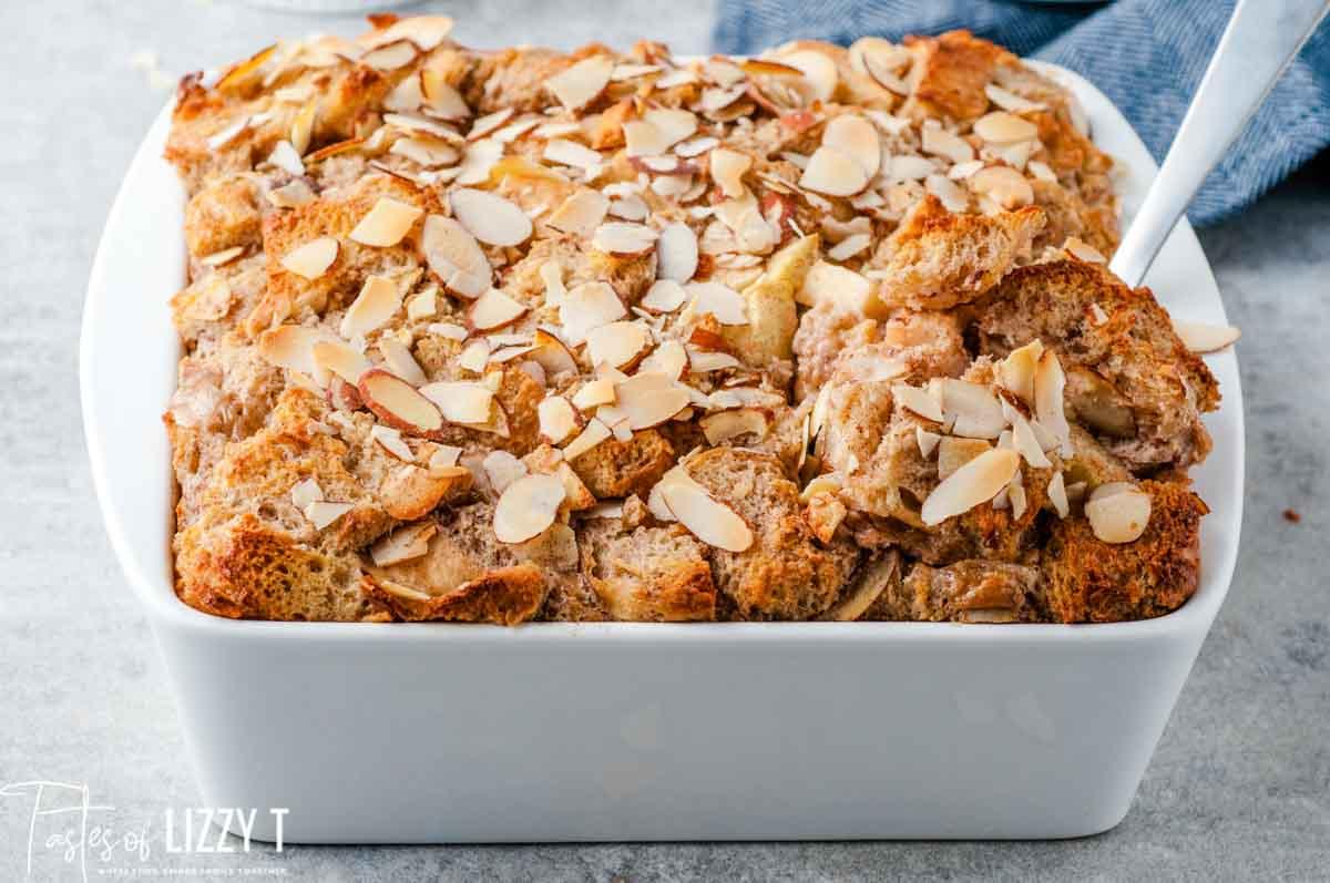 almond apple bread pudding in a casserole dish