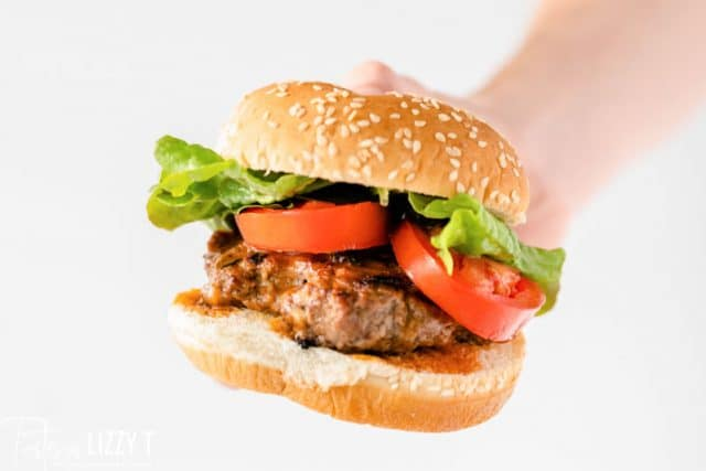 hand holding a burger