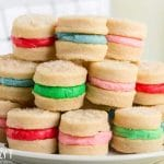 stack of cream wafer sandwich cookies on a plate