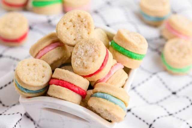 bowl of sugar wafer cookies with colorful frosting