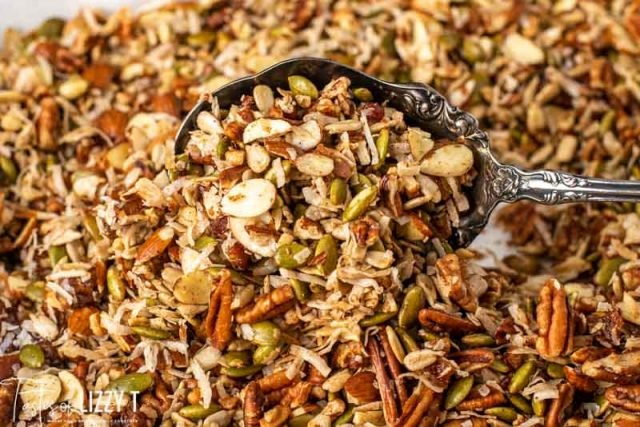 paleo granola on a baking sheet with a spoon
