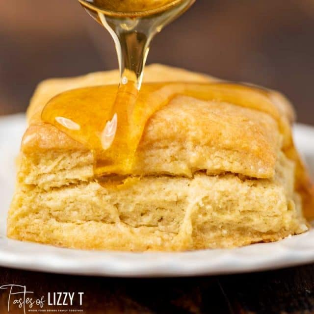 honey pouring on sourdough biscuits