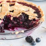 Blueberry Blackberry Pie in a pan with two pieces missing