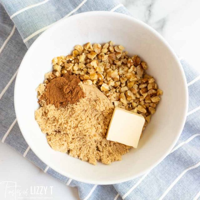 butter, sugar, cinnamon and nuts in bowl