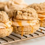 apple cookie sandwiches on a wire rack