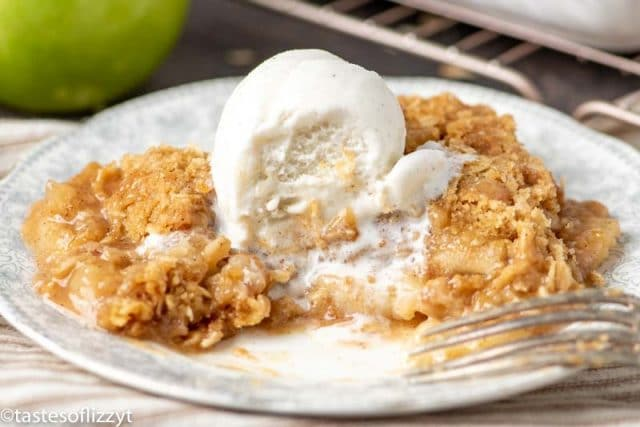 apple crisp with ice cream with a bite out