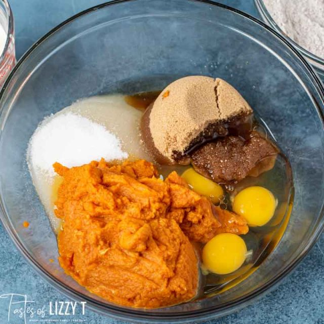 wet ingredients for pumpkin bread in mixing bowl