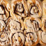 overhead view of glazed cinnamon rolls