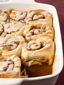 baking pan with cinnamon rolls, one missing