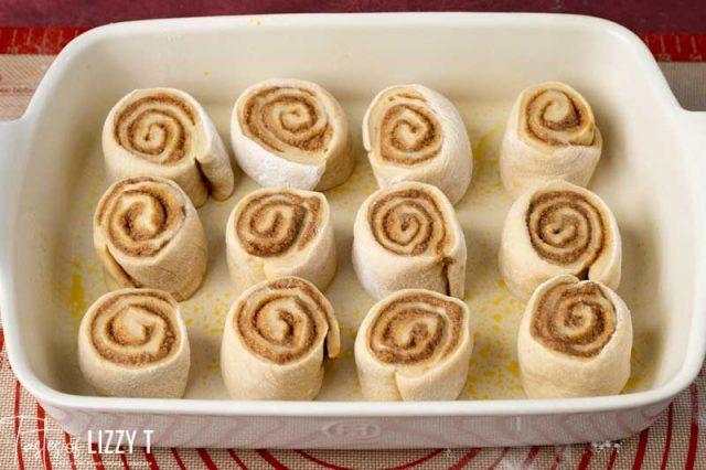 unbaked cinnamon rolls in baking pan