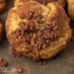 cinnamon crunch pumpkin knot on baking mat