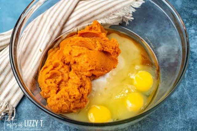 pumpkin, eggs and sugar in a bowl
