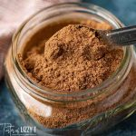 chai spice in a jar with a spoon