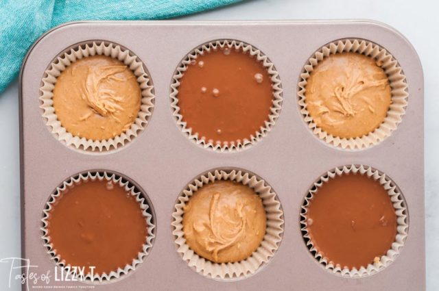 peanut butter cups half made in muffin pan