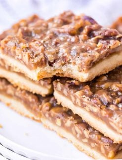 stack of pecan bars with bite out of one