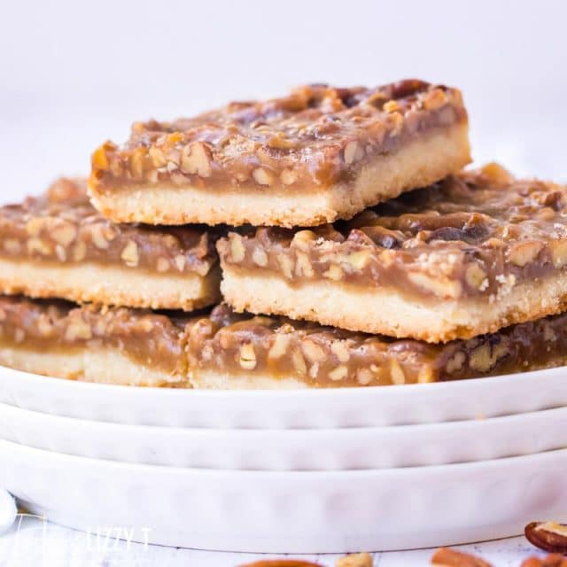 stack of pecan bars on a plate