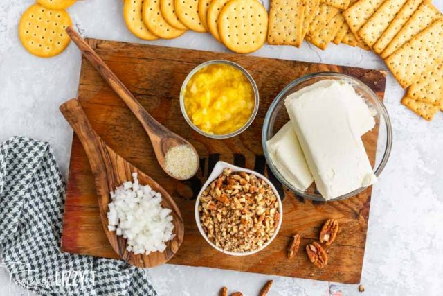ingredients for cheese ball on wooden platter