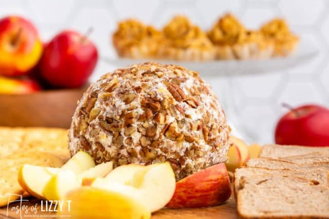pecan cheese ball with fruit on a cutting board