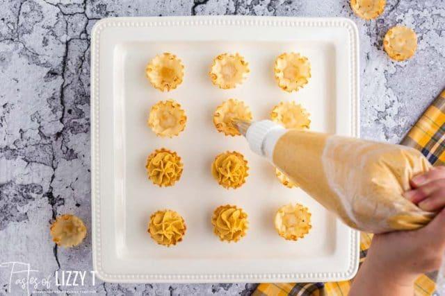 filling pumpkin mini pie shells