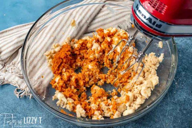 hand mixer creaming butter and pumpkin