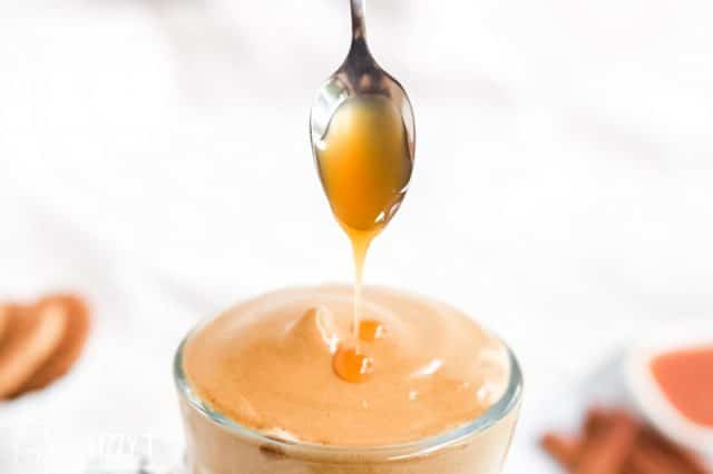 caramel drizzling off spoon