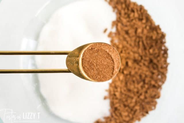 pumpkin pie spice in a measuring spoon