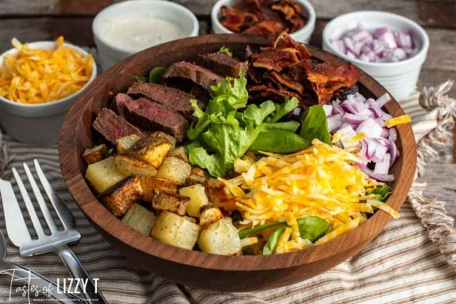 wooden bowl of steak and potato salad