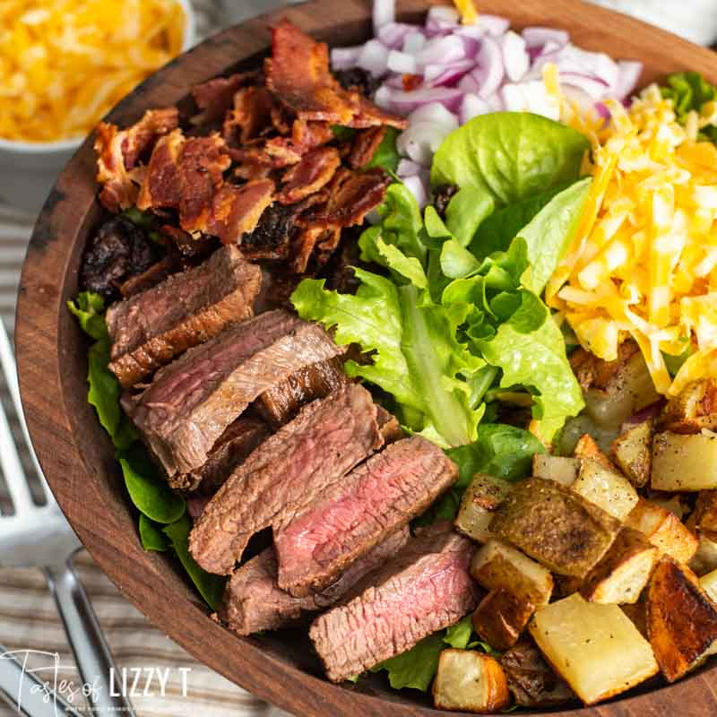 salad with steak, potatoes and bacon