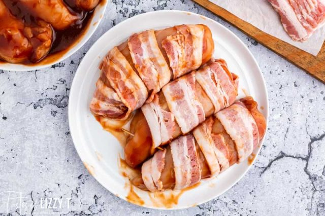 uncooked bacon wrapped chicken