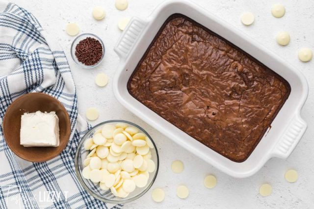 pan of brownies, cream cheese and white chocolate on a table