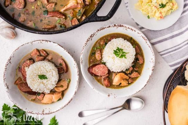 two bowls of chicken sausage gumbo with rice
