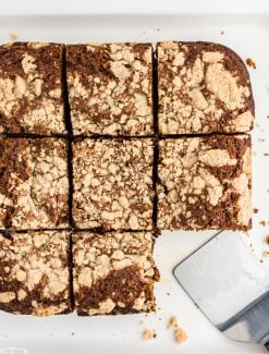 sliced gingerbread streusel cake with one slice missing