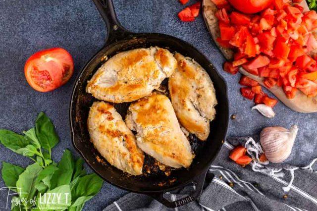 golden brown chicken in a skillet