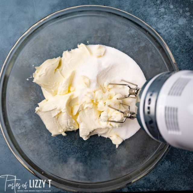 cream cheese and sugar in a mixing bowl