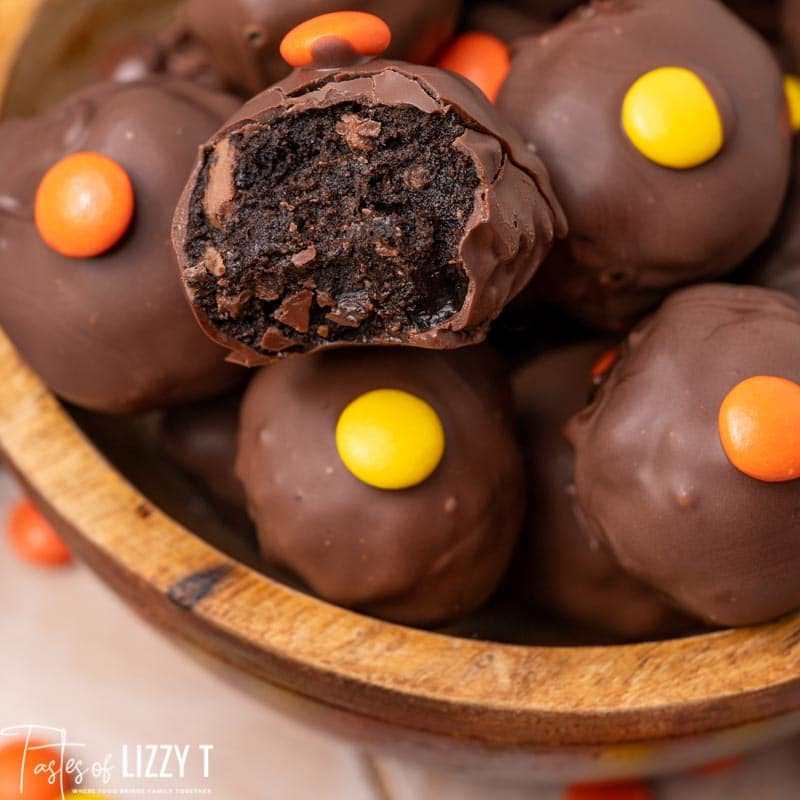 bowl of reese's truffles, one with a bite out