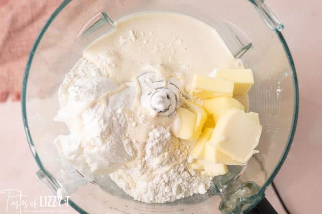ingredients for sourdough pie crust in a food processor