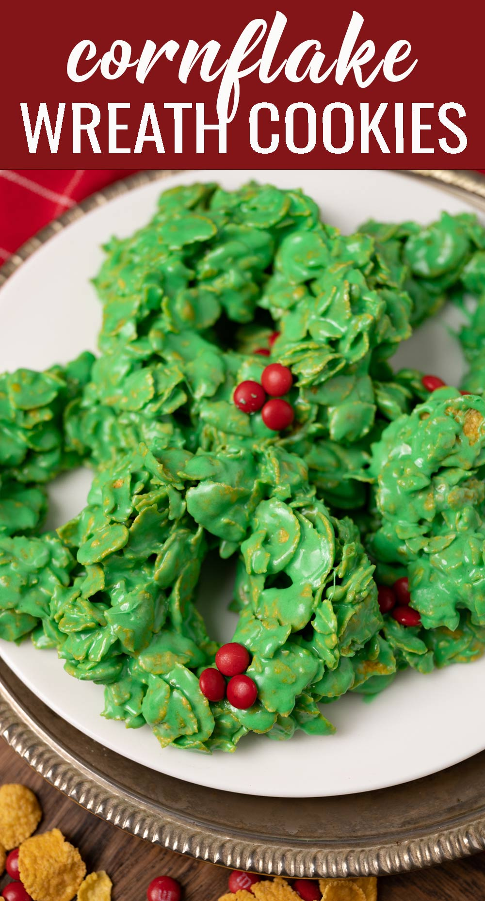 There's nothing prettier for your Christmas cookie plate than these no bake Cornflake Wreath Cookies with mini M&Ms. Let the kids join in on the fun! via @tastesoflizzyt