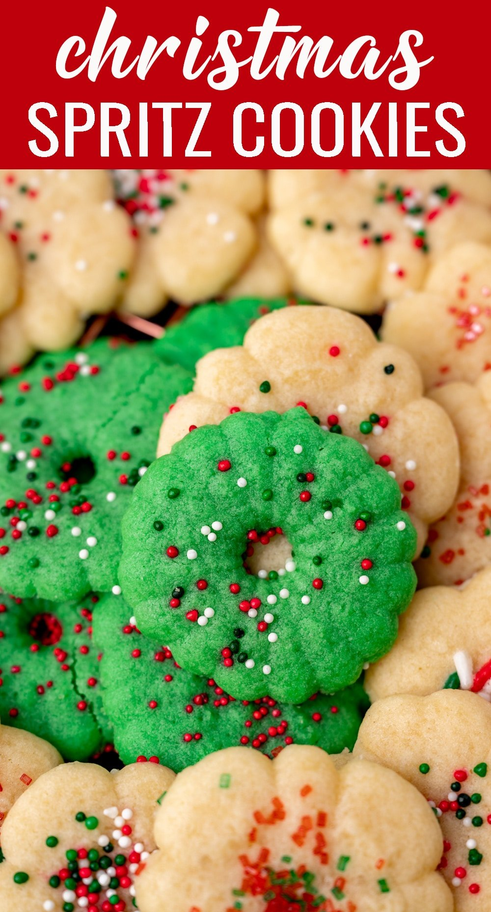 Nothing says the holidays like festive butter spritz cookies! Use a cookie press to make festive shapes for these buttery sugar cookies. via @tastesoflizzyt