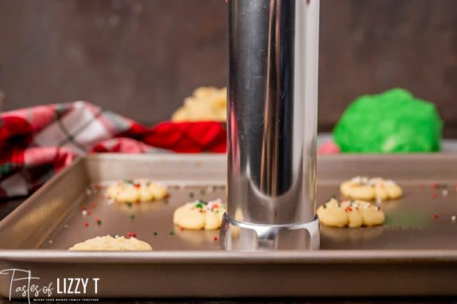cookie press on a cookie sheet