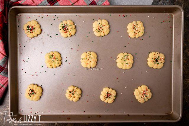 butter spritz cookies on a baking sheet