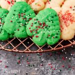 christmas tree cookies with sprinkles on a wire rack